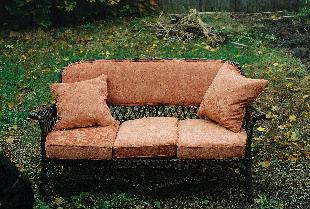 restored wicker sofa was also upholstered