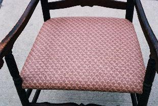 rush seated laderback arm chair done over in upholstery