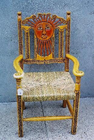 Hand carved and painted mexican arm chair with natural cattail rush seat